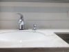 White Ceramic Tile with a Glass Tile Accent Strip - Faucet Close-up