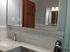 White Ceramic Tile with a Glass Tile Accent Strip