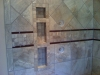 Ceramic Tile with Mosaic Glass Strip Accent including Soap and Shampoo Inset Shelf