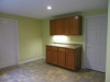 Ceramic Tile Floor in a Kitchen Addition - Cabinet View