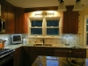 Ceramic Tile Backsplash with Single Center Glass Tile Accent