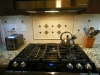 Ceramic Tile Backsplash with Tumbled Stone Accent Focal Point