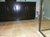 Travertine Tile Floor with Dark Finish Bathroom Vanity with Granite Countertops