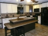 Kitchen Island with Ceramic Tile Floor and Matching Ceramic Tile Backsplash