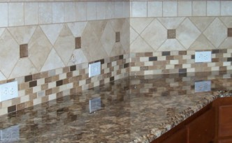 Kitchen remodel with ceramic tile backsplash and glass accents