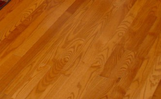 Oak stained hardwood floors in an updated kitchen.