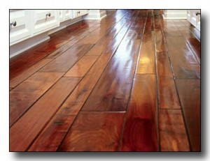 Hand scraped hardwood floors with dark cherry stain.